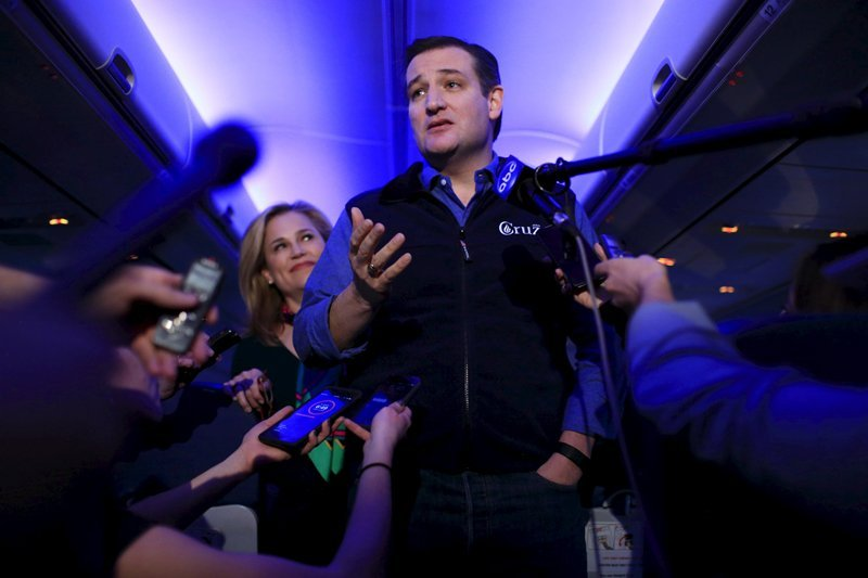 U.S. Republican presidential candidate Ted Cruz and his wife Heidi speak to the press aboard a plane en route to a campaign event in Piedmont
