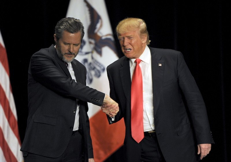 U.S. Republican Presidential candidate Donald Trump shakes hands with Jerry Falwell Jr. during a campaign event in Sioux City Iowa